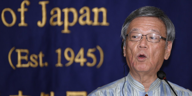 Okinawa Gov. Takeshi Onaga speaks during a press conference at the Foreign Correspondents' Club of Japan in Tokyo Wednesday, May 20, 2015. Onaga said in an interview with The Associated Press Wednesday that he would head to Washington to convey local objections to a plan to relocate a U.S. air base. A plan set in 1996 would move U.S. Marine Air Station Futenma to a less developed area of Okinawa island. (AP Photo/Shizuo Kambayashi)