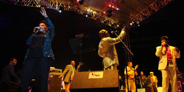 Cuba's singer Omara Portuondo, left, performs with Buena Vista Social Club at the Plaza de Toros Mexico in Mexico City, late Tuesday Nov. 8, 2011.  (AP Photo/Alexandre Meneghini)