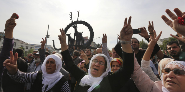 Protesters flash the V-sign as they protest Saturday's bombing attacks, during a rally in Ankara, Turkey, Sunday, Oct. 11, 2015. Turkey declared three days of mourning following Saturday's nearly simultaneous explosions that targeted a peace rally in Ankara to call for increased democracy and an end to the renewed fighting between the Turkish security forces and Kurdish rebels. (AP Photo/Burhan Ozbilici)