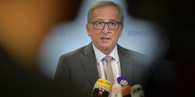 President of the European Commission Jean-Claude Juncker speaks to media during a visit of a migrants registration center in Passau, southern Germany, Thursday, Oct. 8, 2015. (AP Photo/Kerstin Joensson)