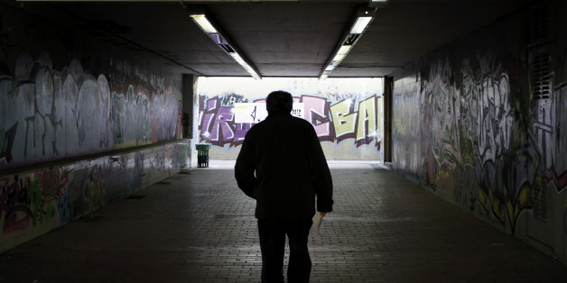 A man walks at an underground pedestrian crossing, in Athens, on Thursday, Nov. 15, 2012. Greece's economy has shrunk by 20 percent since its crisis began in 2009 and unemployment has risen to a record 25 percent. The country is expected to enter a sixth year of recession as investors pull money out of the country and the government keeps cutting spending and raising taxes to comply with the demands of its international bailout. (AP Photo/Petros Giannakouris)