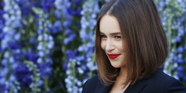 British actress Emilia Clarke poses prior to the start of the Christian Dior 2016 Spring/Summer ready-to-wear collection fashion show, on October 2, 2015 in Paris.                 AFP PHOTO / PATRICK KOVARIK        (Photo credit should read PATRICK KOVARIK/AFP/Getty Images)