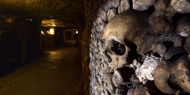 Photo taken on August 7, 2014 at the Catacombs of Paris shows skulls and bones stacked and arranged. These underground quarries were used to store the remains of generations of Parisians in a bid to cope with the overcrowding of Paris' cemeteries at the end of the 18th century, and are now a popular tourist attraction. AFP PHOTO/DOMINIQUE FAGET        (Photo credit should read DOMINIQUE FAGET/AFP/Getty Images)