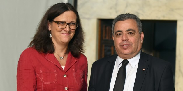 Eurpean Trade Commissioner Cecilia Malmstroem shakes hands with Tunisia's Trade Minister Ridha Lahouel during their meeting on October 13, 2015 in Tunis. Malmstroem began talks in Tunisia towards a free trade deal with Europe, part of the bloc's wider effort to support the crisis-hit nation.  AFP PHOTO /  FETHI BELAID        (Photo credit should read FETHI BELAID/AFP/Getty Images)