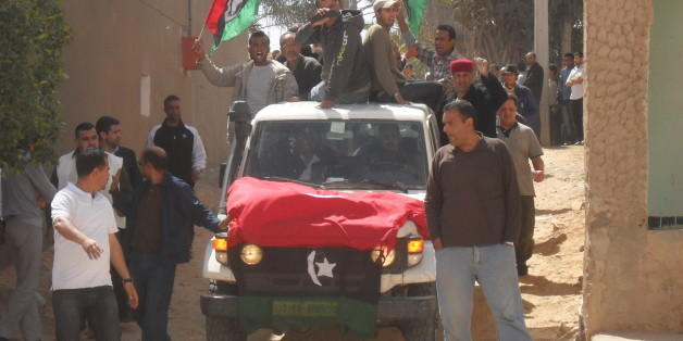 """Refugees and Tataouine residents came together on April 17th to bury Ali Ahmed Jerbi, the first """"Libyan martyr"""" to be interred in Tunisia.  اجتمع اللاجئون وسكان تطاوين يوم 17 أبريل لدفن علي أحمد جابر، أول """"شهيد ليبي""""، يُدفن في تونس.   Les réfugiés et les habitants de Tataouine se sont rassemblés, le 17 avril, lors des funérailles d'Ali Ahmed Jerbi, le premier """"martyr libyen"""" enterré en Tunisie.  Full story: <a href=""""http://www.magharebia.com/cocoon/awi/xhtml1/en_GB/features/awi/reportage/2011/04/22/reportage-01"""" rel=""""nofollow"""">www.magharebia.com/cocoon/awi/xhtml1/en_GB/features/awi/r...</a>  القصة <a href=""""http://www.magharebia.com/cocoon/awi/xhtml1/ar/features/awi/reportage/2011/04/22/reportage-01"""" rel=""""nofollow"""">www.magharebia.com/cocoon/awi/xhtml1/ar/features/awi/repo...</a>  L'article: <a href=""""http://www.magharebia.com/cocoon/awi/xhtml1/fr/features/awi/reportage/2011/04/22/reportage-01"""" rel=""""nofollow"""">www.magharebia.com/cocoon/awi/xhtml1/fr/features/awi/repo...</a>"""