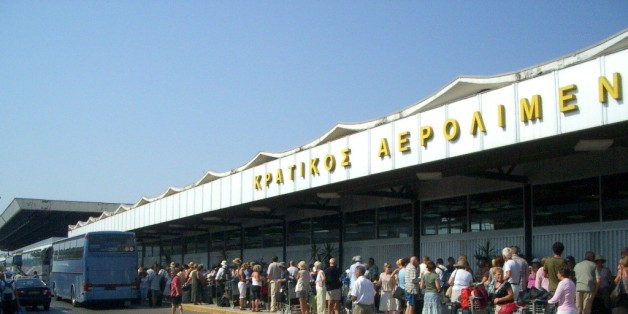 Aaaaaagh!  Hyuge queue in 40 degree heat outside the (full) airport terminal building in Corfu.  NOT fun.
