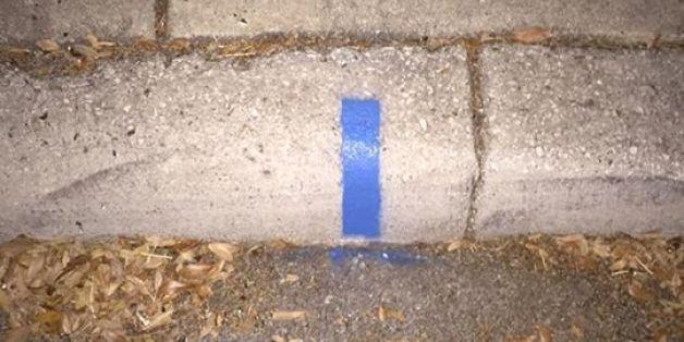Der wahre Grund hinter den blauen Streifen auf Gehwegen.