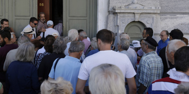 The first customers, most of them pensioners, stand in a queue to enter a branch at National Bank of Greece headquarters in Athens, Monday, July 20, 2015. Greek banks reopen on Monday morning, but many restrictions on transactions, including cash withdrawals, will remain. Also, many goods and services will become more expensive as a result of a rise in Value Added Tax approved by Parliament last Thursday, among the first batch of austerity measures demanded by Greece's creditors. (AP Photo/Thanassis Stavrakis)