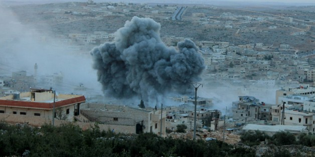 ALEPPO, SYRIA - OCTOBER 13: Smoke rises after Russian war crafts hit the Syrian opposition controlled town Daret Ezza in Aleppo, Syria on October 13, 2015. (Photo by Mamun Abu Omer/Anadolu Agency/Getty Images)