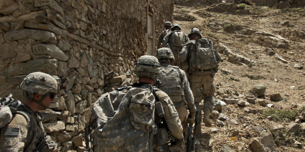 U.S. Army Soldiers of 101 Airborne Division 1st Battalion, Bush Masters (TF No Slack), assisted by Afghan National Army troops move into an over watch position during operation Strong Eagle 2, July 19.