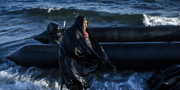 An elderly woman is pictured after arriving on the Greek island of Lesbos, after crossing the Aegean sea from Turkey, on October 15, 2015. More than 400,000 refugees, mostly Syrians and Afghans, arrived in Greece since early January while dozens were drowned trying to make the crossing. In total 710,000 have entered the EU through Greece and Italy during the same period, according to the European Agency Frontex border surveillance. The migration issue has caused deep divisions within the European Union, which is trying to set the distribution of migrants among its member countries or limit the flow.    AFP PHOTO / DIMITAR DILKOFF        (Photo credit should read DIMITAR DILKOFF/AFP/Getty Images)