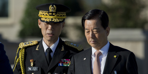 South Korean Defense Minister Han Min-koo, right, arrives at the Pentagon for the full military honors parade to welcome the visiting South Korean President Park Geun-hye to the Pentagon, Thursday, Oct. 15, 2015.   (AP Photo/Manuel Balce Ceneta)