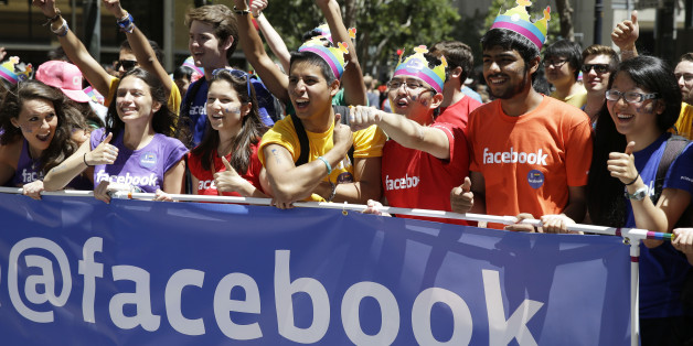 Facebook employees and family members march during the 44th annual San Francisco Gay Pride parade Sunday, June 29, 2014, in San Francisco. The lesbian, gay, bisexual, and transgender celebration and parade is one of the largest LGBT gatherings in the nation. (AP Photo/Eric Risberg)