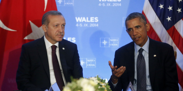 President Barack Obama speaks to reporters as he meets with Turkish President Recep Tayyip Erdogan at the NATO summit at Celtic Manor, Newport, Wales, Friday, Sept. 5, 2014. (AP Photo/Charles Dharapak)