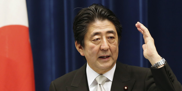 Japanese Prime Minister Shinzo Abe speaks during a press conference at the prime minister's official residence  in Tokyo, Wednesday, Oct. 7, 2015.   Prime Minister Abe has reshuffled his Cabinet to focus on reviving the world's No. 3 economy.  A newly appointed minister will steer programs aimed at achieving a strong economy and increased birth rate so the population stabilizes and the country can stay afloat. (AP Photo/Koji Sasahara)