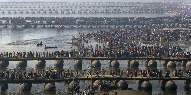 FILE - In this Feb. 10, 2013 file photo, Hindu devotees walk across pontoon bridges to take a holy dip at Sangam, the confluence of the Ganges, Yamuna and mythical Saraswati River, during the Maha Kumbh festival, in Allahabad, India. Philippine officials estimate that as many as 6 million people will attend the Mass that Pope Francis celebrates Sunday, Jan. 18, 2015 in Manila's Rizal Park. That would be a record for any pope, but not for any event. A look at some of the biggest gatherings of humanity: (AP Photo/Manish Swarup, File)
