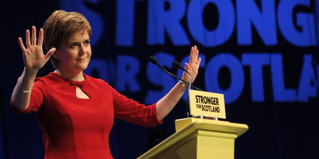 Scotland's First Minister and leader of the Scottish National Party (SNP), Nicola Sturgeon, acknowledges delegates before beginning her keynote address on the final day of the SNP conference in Aberdeen, northeast Scotland, on October 17, 2015.    AFP PHOTO / ANDY BUCHANAN        (Photo credit should read Andy Buchanan,Andy Buchanan/AFP/Getty Images)