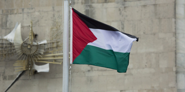 CORRECTS CAPTION TO REMOVE REFERENCE TO STATE OF PALESTINE IN ACCORDANCE WITH AP STYLE - The Palestinian flag flies in the wind after it was raised during a Rose Garden ceremony at the United Nations headquarters on Wednesday, Sept. 30, 2015. Following a vote in November 2012, the U.N. recognized Palestine as a state with non-member status and as a result it was permitted to raise its flag outside the U.N. for the first time on Wednesday. (AP Photo/Craig Ruttle)