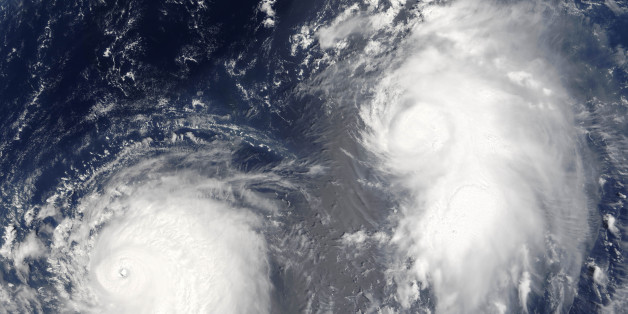 Typhon Mawar (left) and Tropical Cyclone Guchol (right) on 22 August 2005, far out in the northwestern Pacific Ocean, some 900 kilometers from Tokyo. True-colour satellite image using MODIS data., Typhoon Mawar And Tropical Cyclone Guchol, Western Pacific, In 2005, True Colour Satellite Image (Photo by Planet Observer/Universal Images Group via Getty Images)