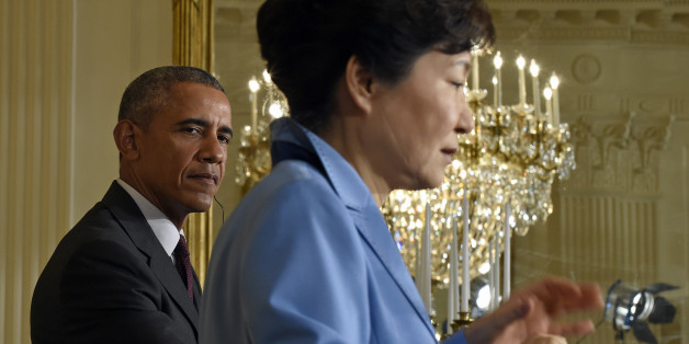 President Barack Obama listens as South Korean President Park Geun-hye speaks during their joint news conference in the East Room of the White House in Washington, Friday, Oct. 16, 2015. (AP Photo/Susan Walsh)