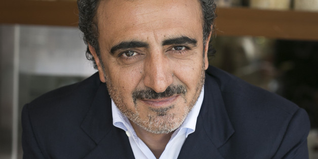 IMAGE DISTRIBUTED FOR CHOBANI, LLC - In this image released on Thursday, May 28, 2015, Chobani's founder and CEO Hamdi Ulukaya at the Chobani Soho café in New York. (Mark Von Holden/AP Images for Chobani, LLC)
