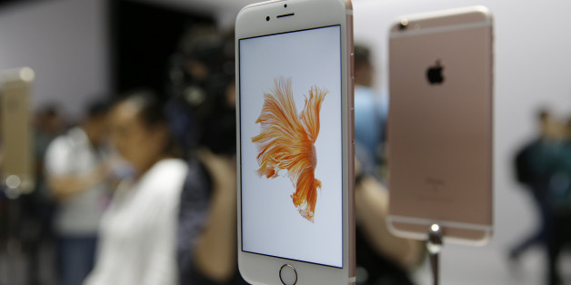 People look over the new Apple iPhone 6s models during a product display following an Apple event Wednesday, Sept. 9, 2015, in San Francisco. (AP Photo/Eric Risberg)