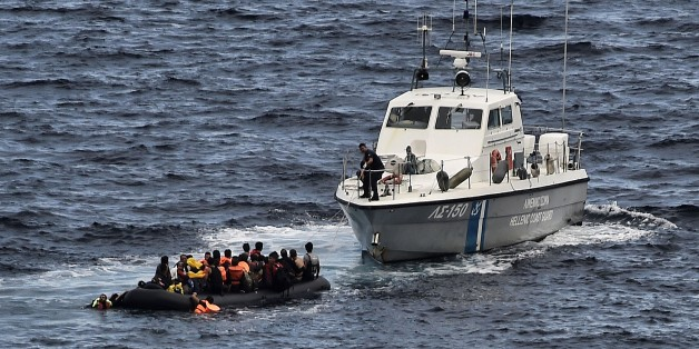 A Hellenic coast guard rescues refugees and migrants on a dinghy as they try to reach the Greek island of Lesbos while crossing the Aegean sea from Turkey on September 29, 2015. More than half a million migrants and refugees have crossed the Mediterranean to Europe so far this year -- 383,000 of them arriving in Greece, the United Nations said. AFP PHOTO / ARIS MESSINIS        (Photo credit should read ARIS MESSINIS/AFP/Getty Images)