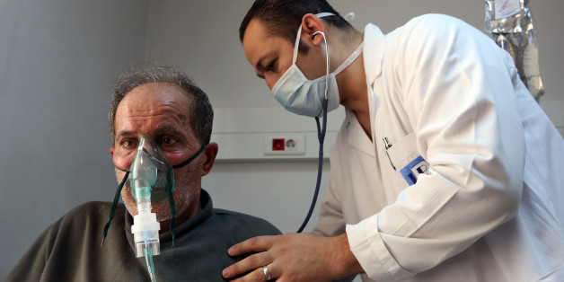 A Lebanese man, who suffers breathing problems caused by a sandstorm, breathes through an oxygen mask as he receives treatment by a doctor, in the Bekaa valley, eastern Lebanon, Tuesday, Sept. 8, 2015. The unseasonal sandstorm hit Lebanon and Syria, covering Beirut and Damascus with a blanket of yellow dust on Tuesday, sending hundreds of people to hospitals with breathing difficulties and causing the deaths of two women, officials said. (AP Photo/Bilal Hussein)