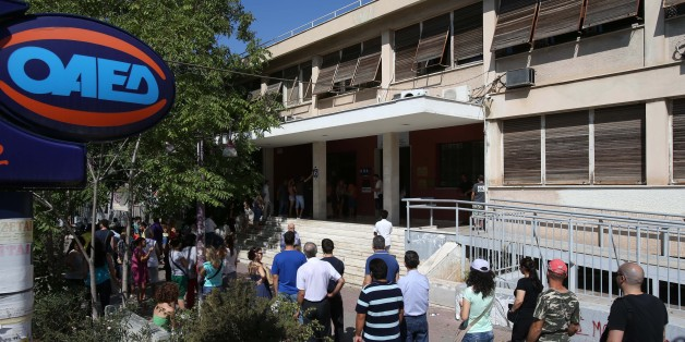 Unemployed Greeks wait in a long line  outside an office of Labor Force Employment Organization (OAED) in Athens, Wednesday, Aug. 7, 2013. The country has been surviving on rescue loans from the IMF and other eurozone countries since 2010, when it lost access to long-term debt markets. Austerity measures demanded in return for the 240 billion euro ($319 billion) bailout program have hammered the economy and seen unemployment surge to 27 percent. Greece's annual economic output is around a fifth smaller than when it entered recession in 2008. (AP Photo/Thanassis Stavrakis)