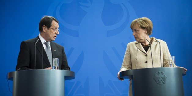 German Chancellor Angela Merkel (R) and  President of Cyprus Nicos Anastasiades speak at a joint press conference following a meeting at the Chancellery in Berlin on May 6, 2014. AFP PHOTO / ODD ANDERSEN        (Photo credit should read ODD ANDERSEN/AFP/Getty Images)