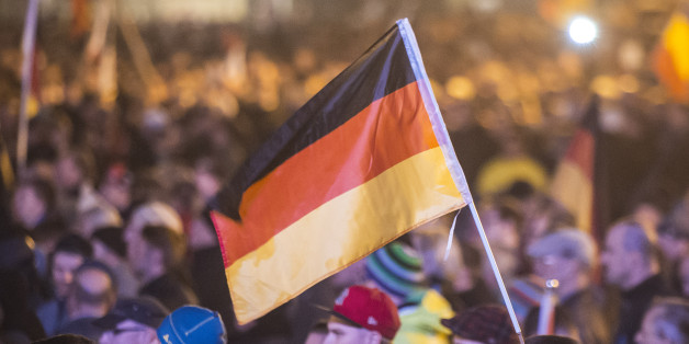 "Protestors attend a demonstration of the PEGIDA (Patriotic Europeans against the Islamization of the West), marking the first anniversary of the anti-Islam group in Dresden, eastern Germany, Monday, Oct. 19, 2015. A surge of migrants to Germany over the summer has fueled a revival of fortunes for the group — whose name stands for ""Patriotic Europeans against the Islamization of the West"" — with crowds to weekly rallies growing steadily. Germany's top security official said the domestic"