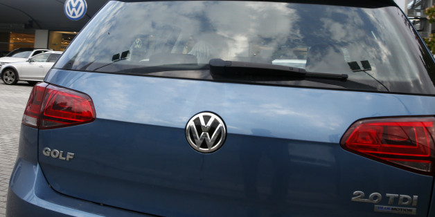 A Volkswagen Golf 2.0 TDI is parked at a Volkswagen dealer in Milan, Italy, Thursday, Oct. 15, 2015. Italian authorities have searched the headquarters of Volkswagen Italia as part of a local investigation into the emissions testing scandal at the German automaker. The financial police in the northern city of Verona conducted the searches on Thursday and confirmed that there are officials under investigation. (AP Photo/Luca Bruno)