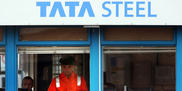 A Tata Steel worker checks his phone after a meeting at the Tata Steel plant in Motherwell, as fears about fresh job losses in the steel industry have been confirmed after Tata announced plans to cut 1,200 posts.