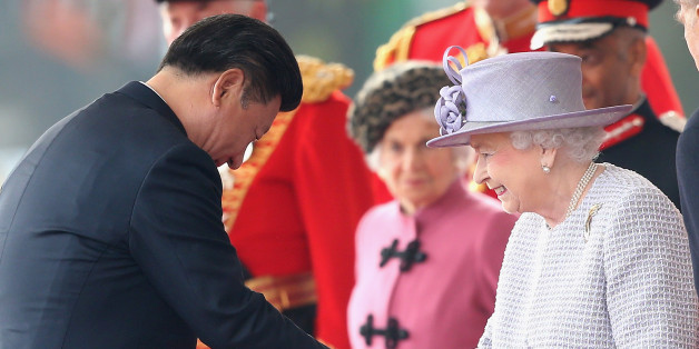 LONDON, ENGLAND - OCTOBER 20:  Queen Elizabeth II shakes hands with Chinese President Xi Jinping on Horseguards Parade during the Official Ceremonial Welcome for the Chinese State Visit on October 20, 2015 in London, England. The President of the Peoples Republic of China, Mr Xi Jinping and his wife, Madame Peng Liyuan, are paying a State Visit to the United Kingdom as guests of The Queen.  They will stay at Buckingham Palace and undertake engagements in London and Manchester. The last state vis