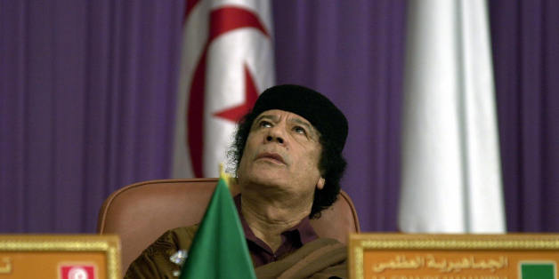 TUNIS, TUNISIA:  Libyan leader Moamar Kadhafi attends the 'Dialogue 5+5' Euro-Magrabian summit, 05 December 2003, in Tunis. Leaders of five southern European and five north African countries gathered in Tunis for a summit which was also set to be marked by controversy over human rights.              AFP PHOTO FETHI BELAID  (Photo credit should read FETHI BELAID/AFP/Getty Images)