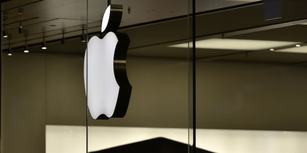 The Apple logo is pictured at the Apple store in Oberhausen, Germany, as Apple Inc. launches worldwide the sales of the new iPhones on early Friday, Sept. 25, 2015. People camped in front of the store for severals days to be the first. Apple is counting on sales of their new smartphones to maintain its position as one of the most profitable, and valuable, companies in the world. (AP Photo/Martin MEissner)