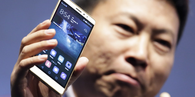CEO of Huawei Consumer Business Group Richard Yu presents the Huawei Mate S smartphone during a company event ahead of the consumer electronic fair IFA in Berlin, Wednesday, Sept. 2, 2015. Europe's flagship gadget show, the IFA, opens its doors to the public on Friday, Sept. 4, 2015. Almost 1,500 companies and over 250,000 visitors are expected to attend the event, which runs until Sept. 9. (AP Photo/Markus Schreiber)