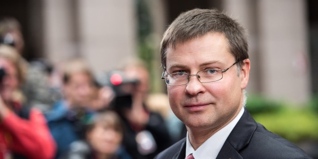 Latvian Prime Minister Valdis Dombrovskis arrives for an EU summit on Thursday, Oct. 24, 2013. A two-day summit meeting of EU leaders is likely to be diverted from its official agenda, economic recovery and migration, after German Chancellor Angela Merkel complained to U.S. President Barack Obama that U.S. intelligence may have monitored her mobile phone. (AP Photo/Geert Vanden Wijngaert)