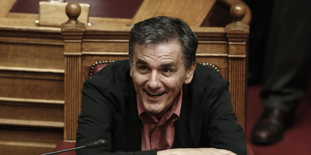 Greece's Finance Minister Euclid Tsakalotos smiles during a parliament vote on a new austerity reform package in Athens, Oct. 17, 2015. Greece's Prime Minister Alexis Tsipras faces his first test in the country's newly elected parliament Friday since a bailout rebellion split his party and triggered a snap general election last month.  (AP Photo/Yorgos Karahalis)