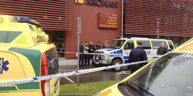 Emergency services attend the scene after a masked man attacked people with a sword, at the Kronan school in Trollhattan, near Goteborg, Sweden, Thursday Oct. 22, 2015. At least six people were injured, and the offender was shot by the police. (Stig Hedstrom / TT via AP) SWEDEN OUT