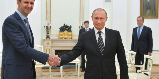 In this photo taken on Tuesday, Oct. 20, 2015, Russian President Vladimir Putin, center, shakes hand with Syrian President Bashar Assad as Russian Foreign Minister Sergey Lavrov, right, looks on in the Kremlin in Moscow, Russia. President Bashar Assad was in Moscow, in his first known trip abroad since the war broke out in Syria in 2011, to meet his strongest ally Russian leader Vladimir Putin. The two leaders stressed that the military operations in Syria_ in which Moscow is the latest and most