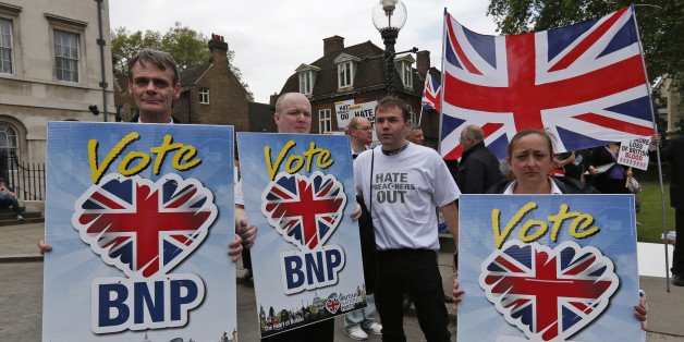 Members of the British National Party (BNP), hold placards during a demonstration in central London, Saturday, Jun. 1, 2013. British National Party supporters gathered to protest the May 22 killing of British soldier Lee Rigby. (AP Photo/Lefteris Pitarakis)