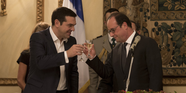 French President Francois Hollande, right and Greek Prime Minister Alexis Tsipras raise their glasses during a dinner at the Presidential Palace in Athens, Thursday, Oct. 22, 2015. Hollande is in Greece for a two-day visit, as Greece seeks help from European rescue lenders for relief on its massive bailout debts. (AP Photo/Petros Giannakouris)