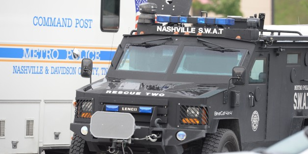 ANTIOCH, TN - AUGUST 05:  SWAT and Nashville Metro Police trucks park outside Hickory Hollow Cinemas on August 5, 2015 in Antioch, Tennessee.  According to reports, an unidentified 29-year-old man armed with a gun and hatchet sprayed three people with a chemical believed to be pepper spray and injured another with a minor wound from the hatchet. The man was later killed by police after exchanging fire outside the theater. (Photo by Jason Davis/Getty Images)