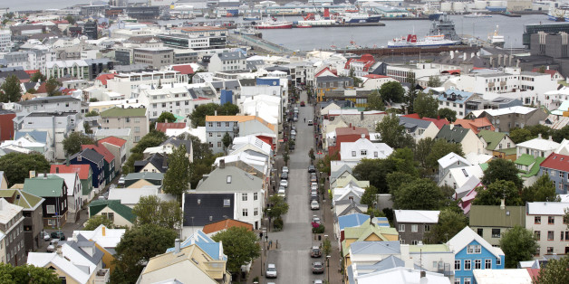 Multicolored rooftops and the harbour are seen on the city skyline in Reykjavik, Iceland, on Friday, Aug. 10, 2012. Iceland is betting its decision two years ago to force bondholders to pay for the banking system's collapse may help it rebound faster than Ireland. Photographer: Arnaldur Halldorsson/Bloomberg via Getty Images