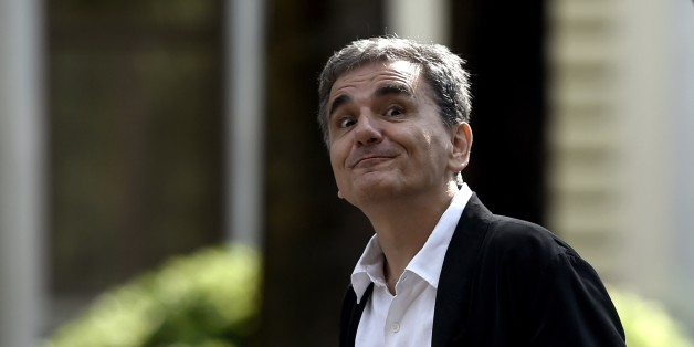 Greek Finance Minister Euclides Tsakalotos grimaces as he leaves the presidential palace after the swearing-in ceremony of the new government in Athens on September 23, 2015. Greek Prime Minister Alexis Tsipras took office with a core of returning ministers pledging to restart the country's flagging economy. AFP PHOTO / ARIS MESSINIS        (Photo credit should read ARIS MESSINIS/AFP/Getty Images)