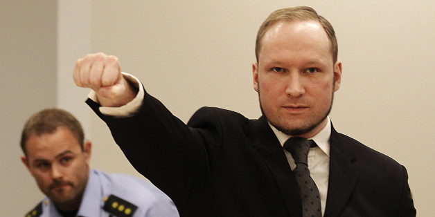 FOR USE AS DESIRED, YEAR END PHOTOS - FILE - In this Aug. 24, 2012 file photo, mass murderer Anders Behring Breivik, makes a salute after arriving in the court room at a courthouse in Oslo.   Breivik, who admitted killing 77 people in Norway last year, was declared sane and sentenced to prison for bomb and gun attacks. (AP Photo/Frank Augstein, File)