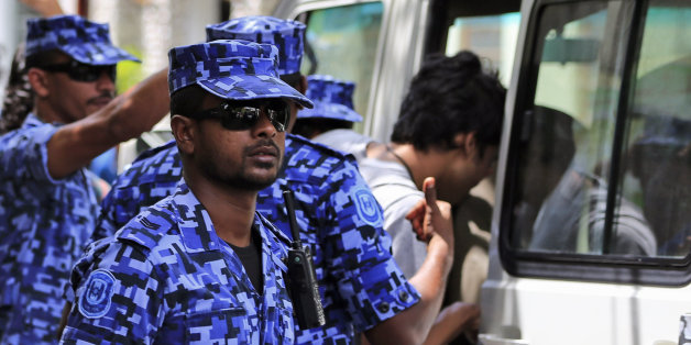 Maldivian police force guard after the arrest of Vice President Ahmed Adeeb in Male, Maldives, Saturday, Oct. 24, 2015. Police in the Maldives arrested Adeeb on Saturday in connection with an explosion aboard the president's boat last month that authorities have said was an assassination attempt. (AP Photo/Sinan Hussain)