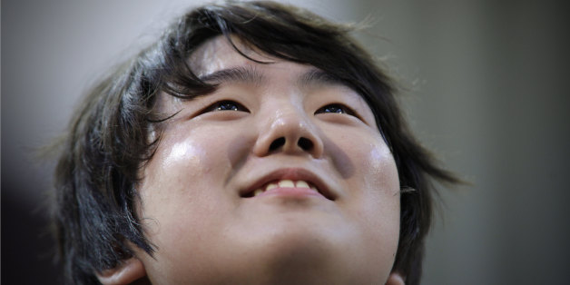 Jin Cho of Korea reacts after playing piano during the third round of XIV International Tchaikovsky Competition in Moscow,  Russia, Wednesday, June 29, 2011.(AP Photo/Alexander Zemlianichenko)