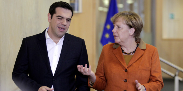 German Chancellor Angela Merkel, right, speaks with Greek Prime Minister Alexis Tsipras prior to a round table meeting during an EU summit at EU headquarters in Brussels on Sunday, Oct. 25, 2015. EU leaders meet on Sunday to discuss refugee flows along the Western Balkans route. (AP Photo/Francois Walschaerts)